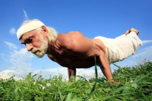 A older man performing a planche maintaining a lifetime of movement