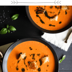 Pinterest graphic for creamy tomato soup with grilled cheese croutons and basil oil.