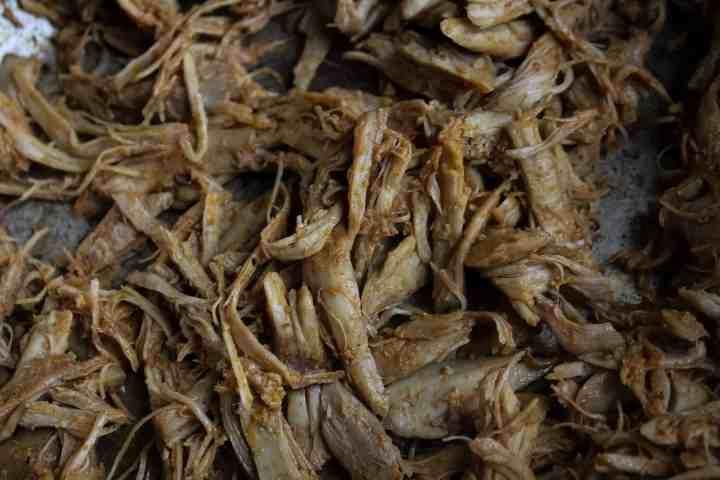 shredded leftover turkey in saute pan