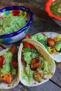 roasted vegetable tacos with salsa verde and mashed avocado