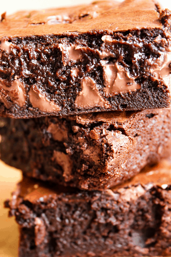 close-up of three fudgy double chocolate brownies stacked atop one another