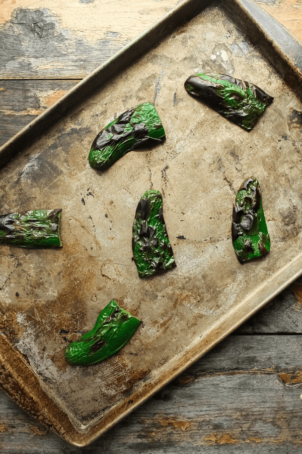 broiled jalapeno slices on sheet pan from above