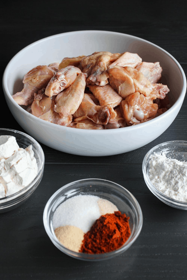 Ingredients for chicken wings on grey surface.