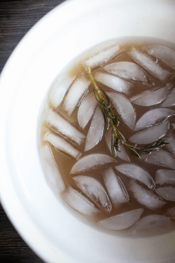 Top down shot of apple cider brine with ice.