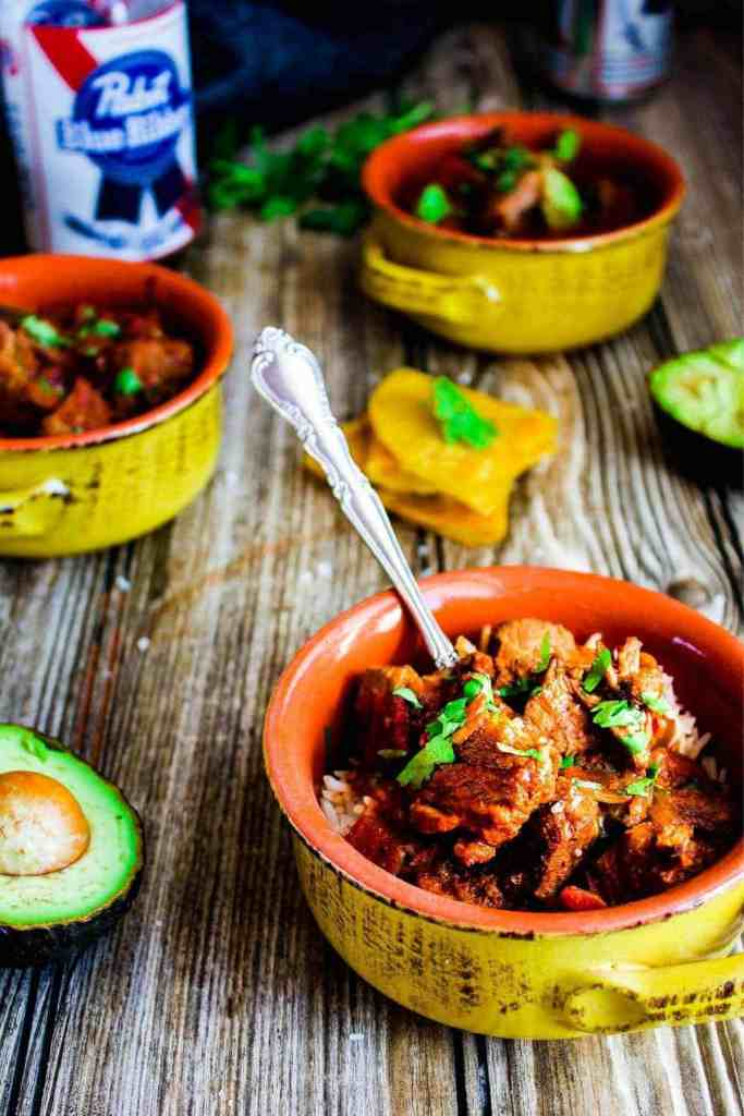 Three bowls of chili with quesadillas, avocado, and PBR.