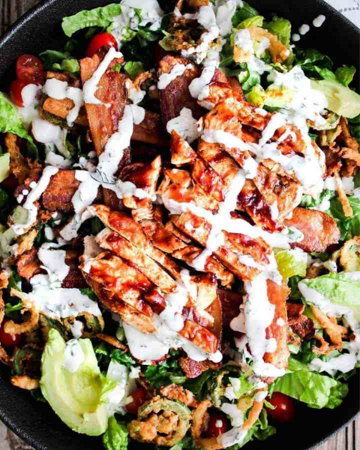 Top down shot of bowl of bbq chicken bacon ranch salad.
