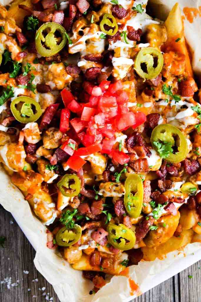 Loaded fries on a platter.