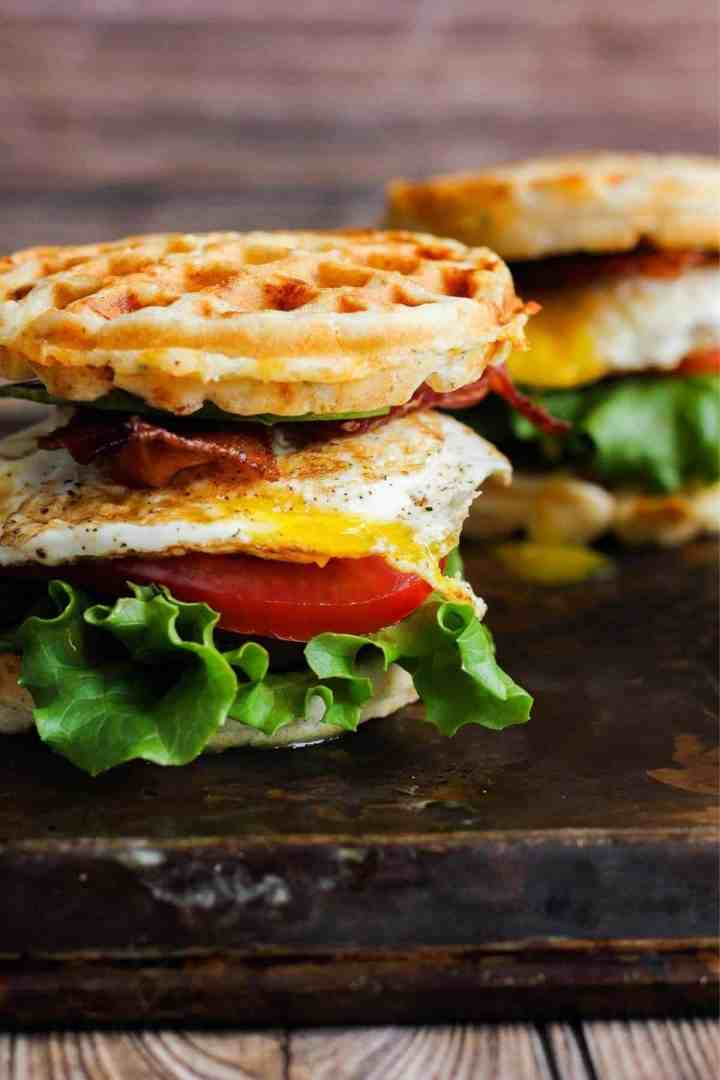 Two breakfast sandwiches on a sheet pan.