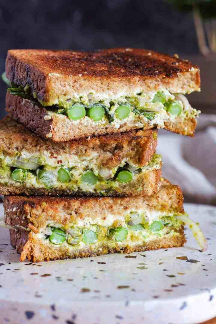 Three sandwich halves stacked.