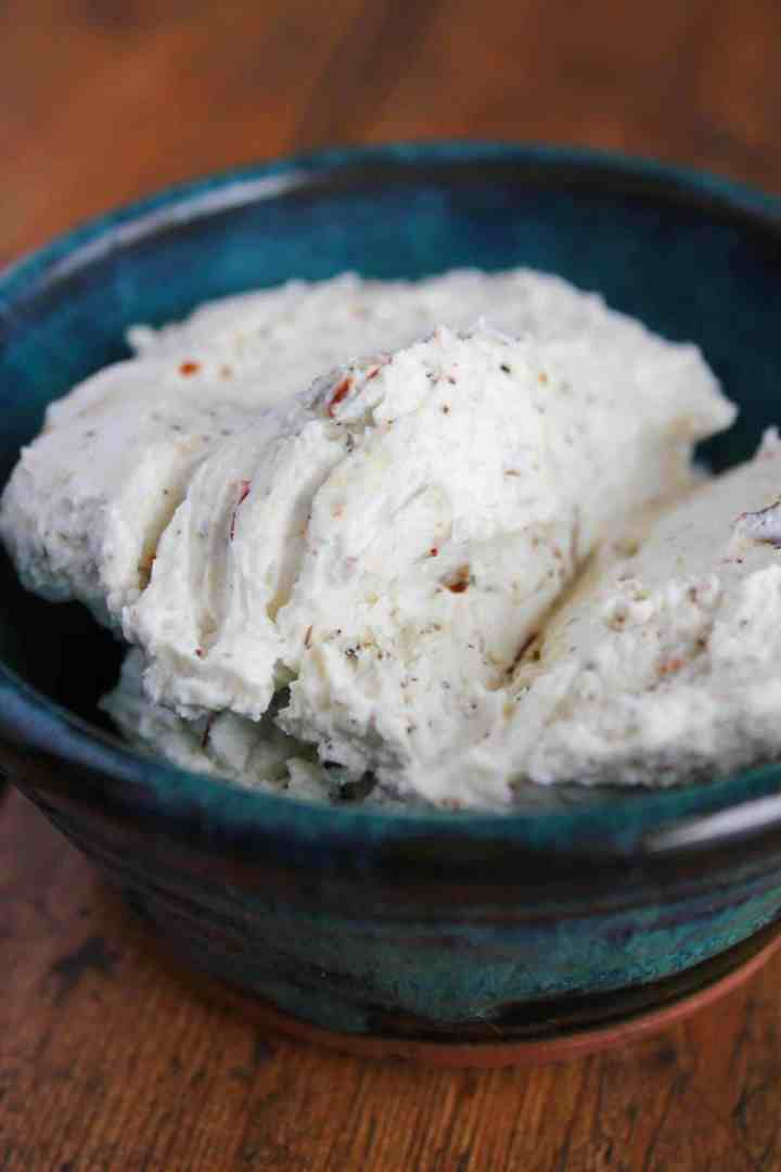 Goat cheese mixture in a blue bowl.