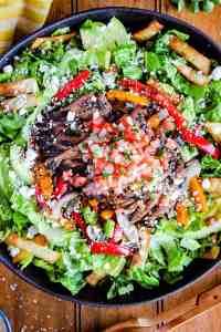Bowl of loaded steak fajita taco salad.