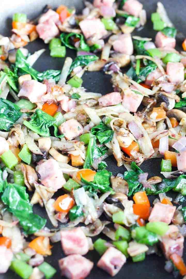Sauteed veggies and ham up close.