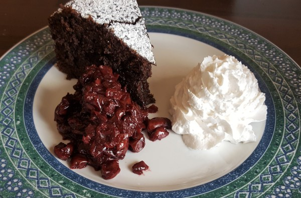 Nutty Chocolate Cake with Cherries and Cream