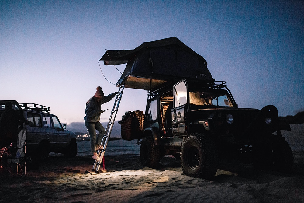 Jeep Wrangler with tent, on beach