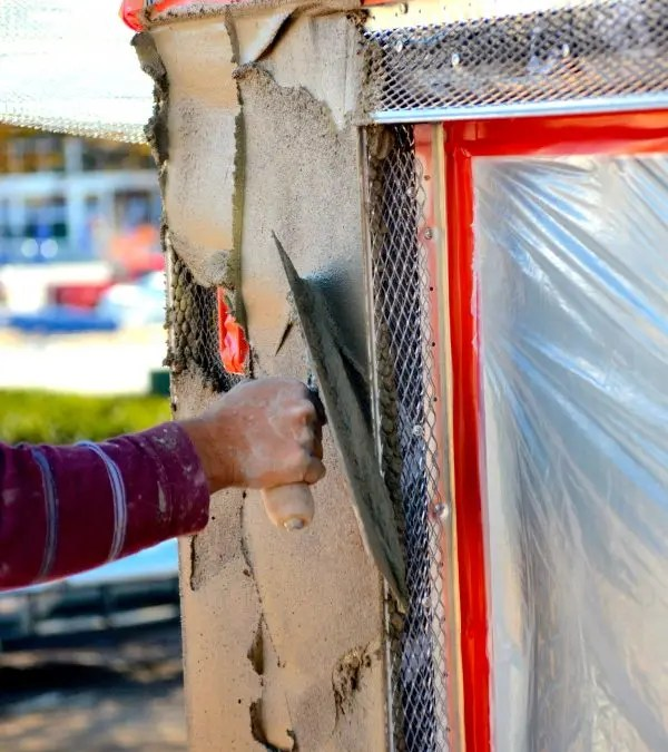 Why is stucco popular in certain climates?