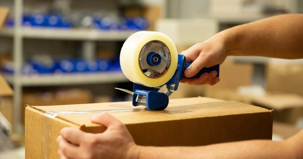 Sealing a box with acrylic tape using hand dispenser