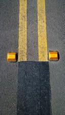 Orange reflectors and double yellow lines