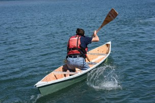 Person rowing a boat.