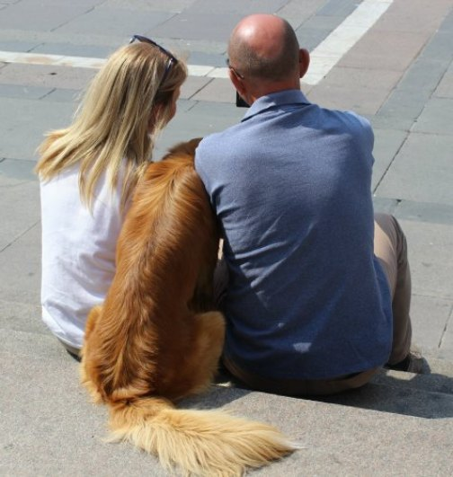 happy couple with dog