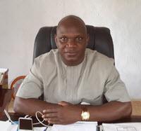 The Honourable Commissioner, Dr. David Ishaya