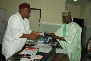 Gov. Ishaku Receiving Report of Ultra Modern Market.
