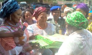 Her Excellency and the Commissioner for Women Affairs giving out gifts to vulnerable groups