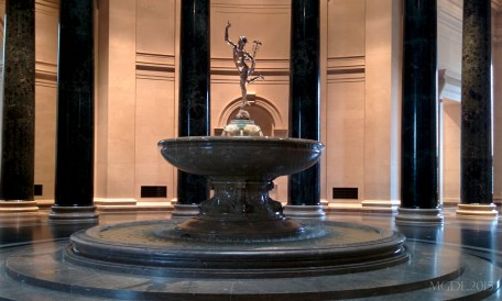 Mercury soars above the elegant marble fountain in the Rotunda of NGA.