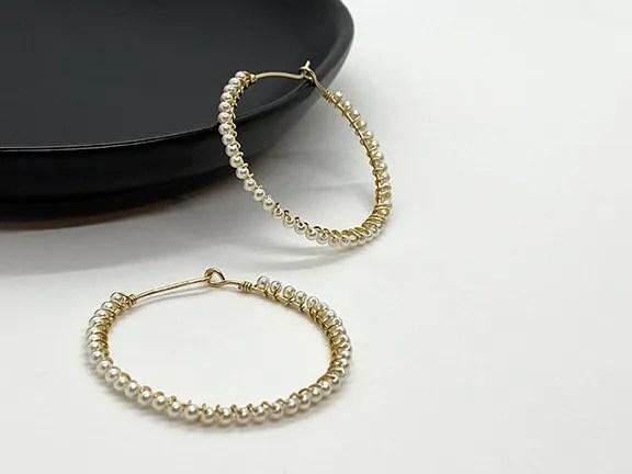 Pearl wrapped gold hoop earrings