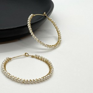 Pearl wrapped gold hoop earrings