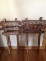 Custom signs upcycled from palette boards for a beach wedding