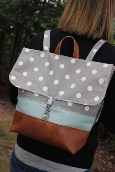"The ""Handy Haversack"" in gray polk-a-dot and coordinating blue canvas with faux leather trim"