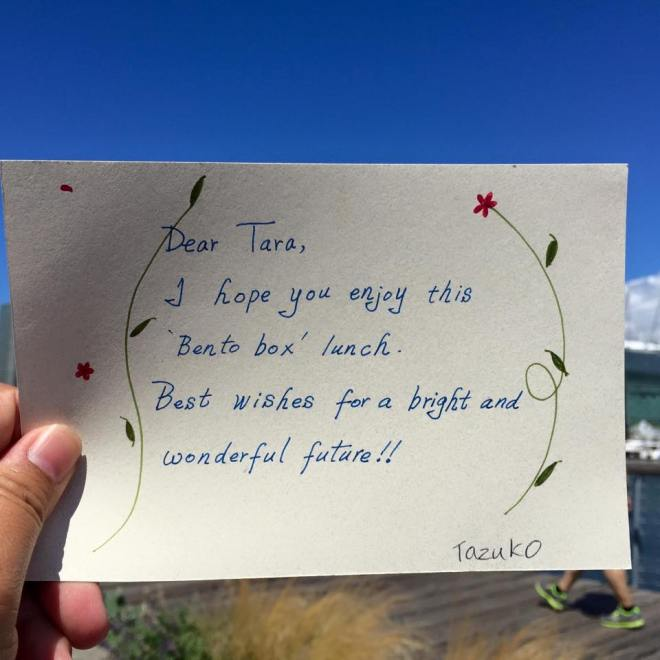 "Handwritten note: ""Dear Tara, I hope you enjoy this 'Bento box' lunch. Best wishes for a bright and wonderful future!! Tazuko"""