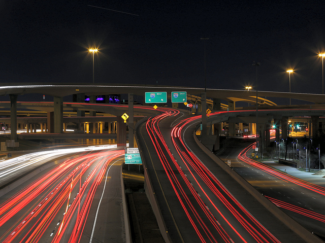 slow exposure photo of a freeway with two on-ramps that go off in different directions