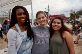 Kathryn Harrigan, 19, from St. Augustine, Florida, Jasmin Quinones, 19, from Orlando, Florida, and Hasani Malone, 19, from Fayetteville, Georgia smile together during Dining with Dignity in St. Augustine, Florida on Wednesday, February 8, 2017. Every week that Flagler participates in Dining with Dignity, Harrigan, Quinones, and Malone contribute by cooking the food for the homeless.