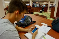"Scott Rowan, 23, having a hard time studying for a test in the Flagler College library in St. Augustine, Florida on Thursday, March 9, 2017. Rowan stated that, ""I usually have to turn my phone off so I can actually get my work done. If it is on, I always end up distracting myself with it."""
