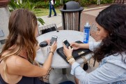 Genna DeFalco, 21, and Rachel Kennedy, 21, using their phones simultaneously in Kenan plaza on the Flagler College campus in St. Augustine, Florida on Thursday, March 9, 2017. According to Psychology Today, young adults have grown accustomed to interacting socially through their phones rather than in person.