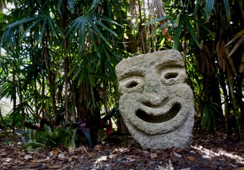 A cheerful smiling stone displayed amongst the foliage at the Washington Oaks Gardens in Palm Coast, Florida on Wednesday, March 29, 2017. The Youngs designed the layout of the garden and house, and they came up with the name Washington Oaks.