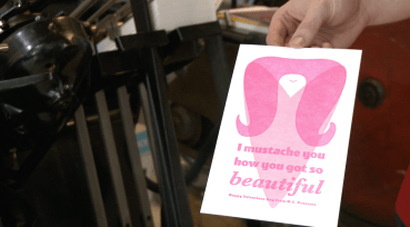 "Ryan Tempro, 26, holding his printed card creation in his letterpress shop in St. Augustine, Florida on Monday, February 13, 2017. Tempro explains his purpose by stating, ""I do what I do because it is something that I just, there is just a lot of what it is attached to is this sort of idea of a physical tangible card or a piece of paper, which is just much more romantic about that than just sending someone an email or a text or something."""