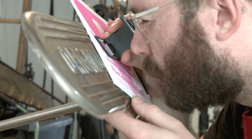 Ryan Tempro, 26, using a magnifying glass piece to analyze his work in his letterpress shop in St. Augustine, Florida on Monday, February 13, 2017. Tempro always ensures that his prints are well organized and printed.