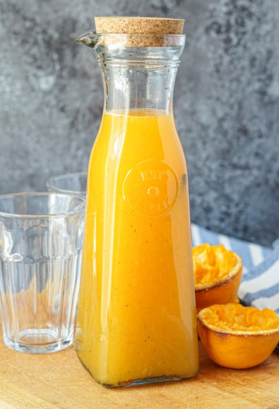 Roasted Vanilla Orange Juice in a carafe with a cork on top