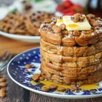 A stack of five Gingerbread Waffles on a blue and white plate.