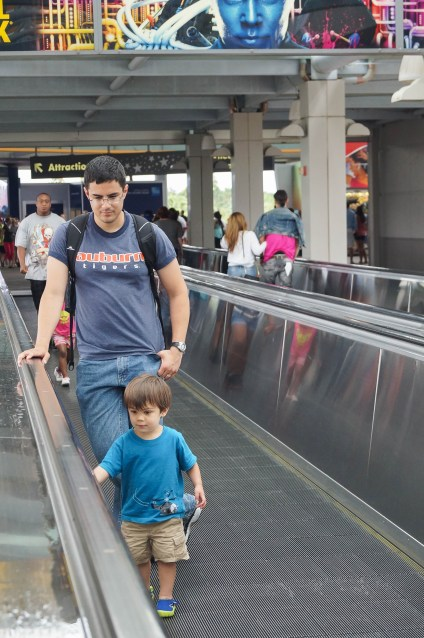 Standing on the moving walkway at Universal Orlando.