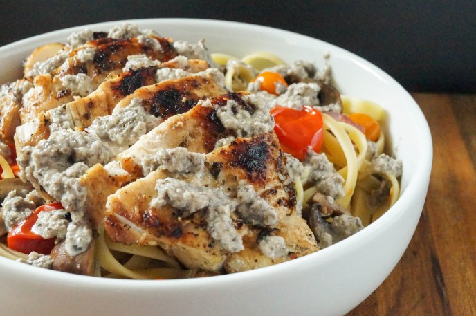 Close up of Fettuccine with Mushroom Cream Sauce in a large white bowl.