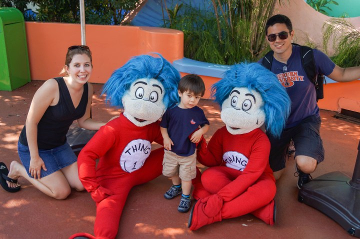 Mom, Dad, and son taking a photo with Thing 1 and Thing 2.