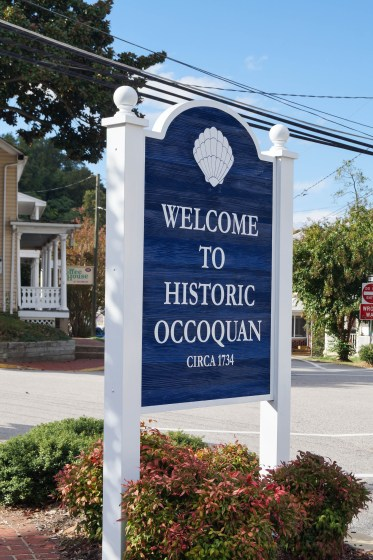 Welcome to Historic Occoquan blue and white sign.