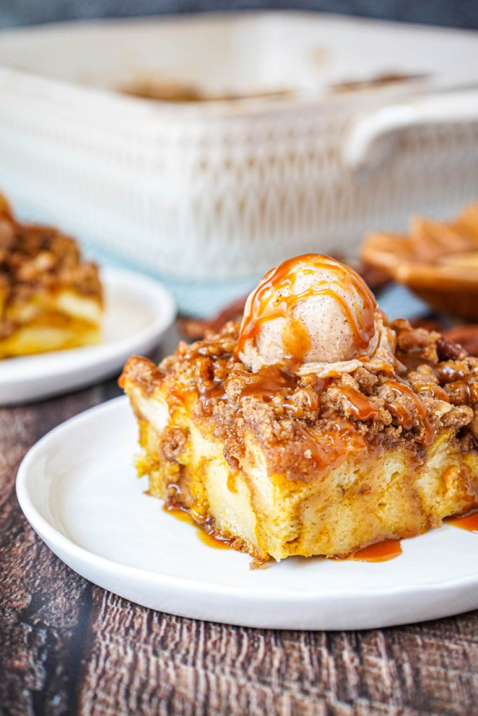 Close up of Pumpkin French Toast Casserole topped with maple butter and caramel sauce.