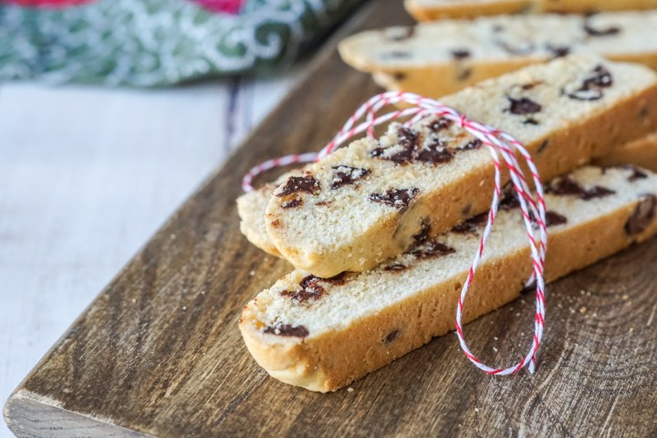 Close up of three stacked Chocolate Chip Biscotti wrapped in a red/white thread.