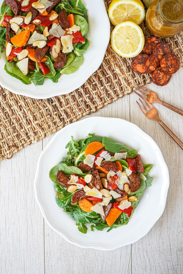Aerial view of Chorizo and Sweet Potato Salad on two white plates.