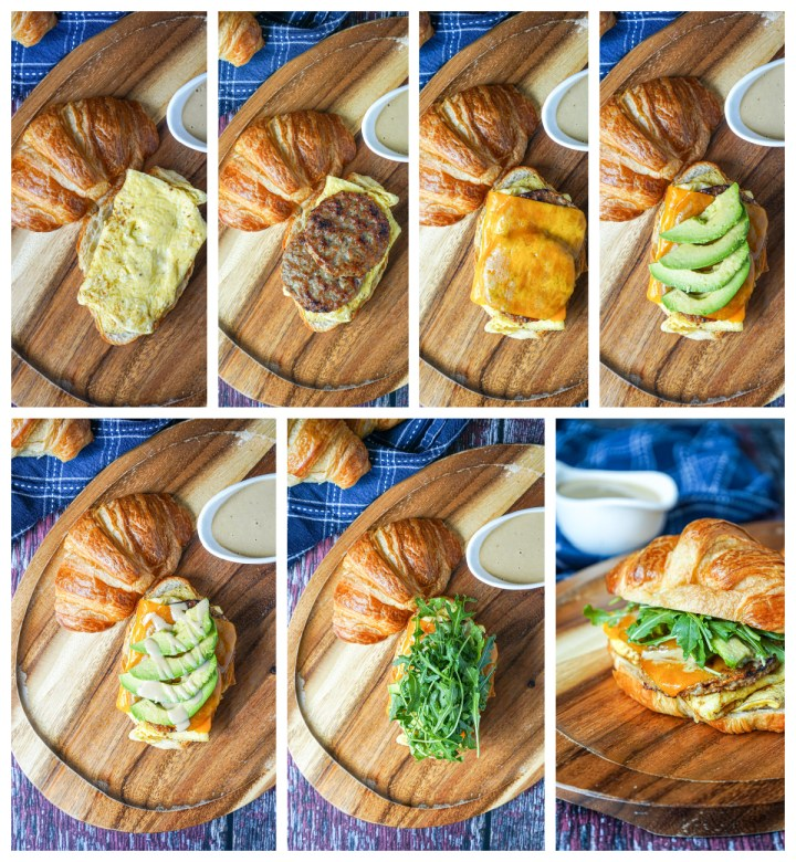 Assembling the Croissant Breakfast Sandwich- topping with cheese, sausage, cheese, avocado, sauce, and arugula.