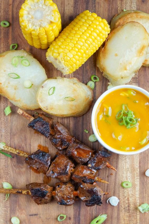 Anticuchos de Corazón (Peruvian Beef Heart Skewers) with corn and potatoes
